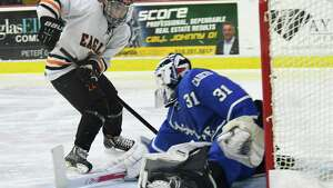 Bethlehem's Justin Chenaille shoots the puck past La Salle goalie Casey Boone during the Division I Sectional Final at Union College in Schenectady, N.Y., Tuesday, Feb. 27, 2018. (Jenn March, Special to the Times Union)