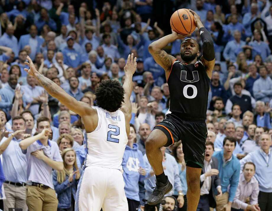 Miami's Ja'Quan Newton (0) shoots the game-winning shot as time expires while North Carolina's Joel Berry II (2) defends during the second half of an NCAA college basketball game in Chapel Hill, N.C., Tuesday, Feb. 27, 2018. Miami won 91-88. (AP Photo/Gerry Broome) Photo: Gerry Broome / Copyright 2018 The Associated Press. All rights reserved.
