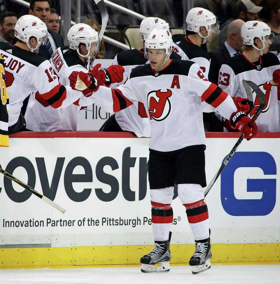 New Jersey Devils' Taylor Hall (9) celebrates his goal as he returns to the bench during the second period of an NHL hockey game against the Pittsburgh Penguins in Pittsburgh, Tuesday, Feb. 27, 2018. (AP Photo/Gene J. Puskar) Photo: Gene J. Puskar / Copyright 2018 The Associated Press. All rights reserved.