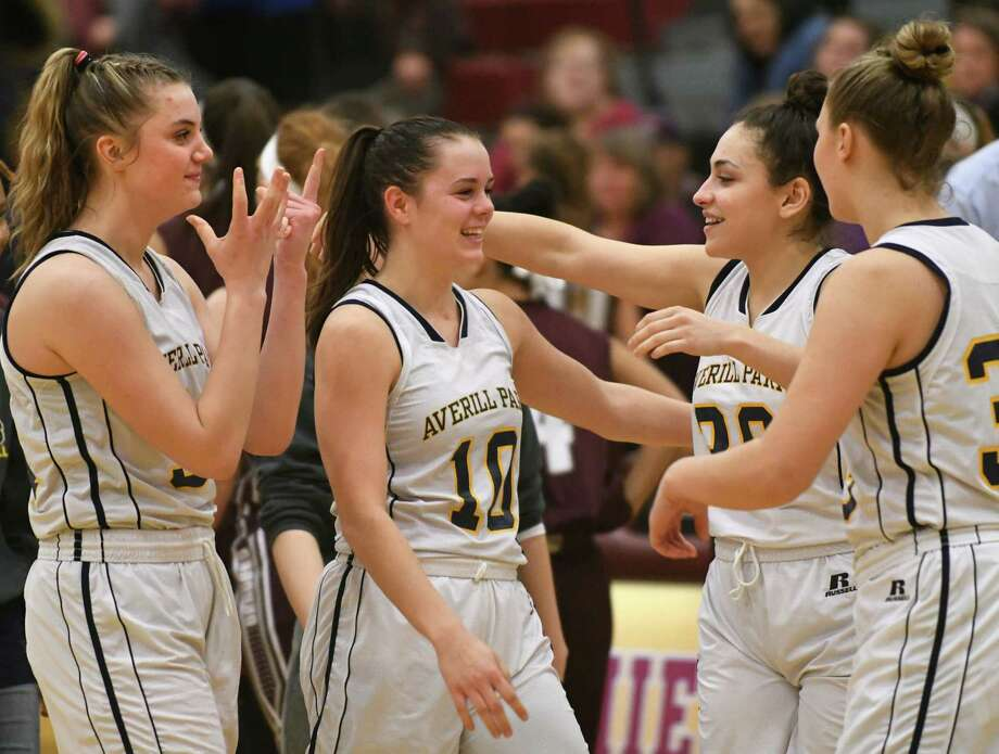 Averill Park's Stephanie Jankovic, second from left, celebrates with her teammates after making her 1000th point of her career a couple minutes before winning a Class A girls' semifinal basketball game against Gloversville on Tuesday, Feb. 27, 2018 in Colonie, N.Y. (Lori Van Buren/Times Union) Photo: Lori Van Buren / 20043042A