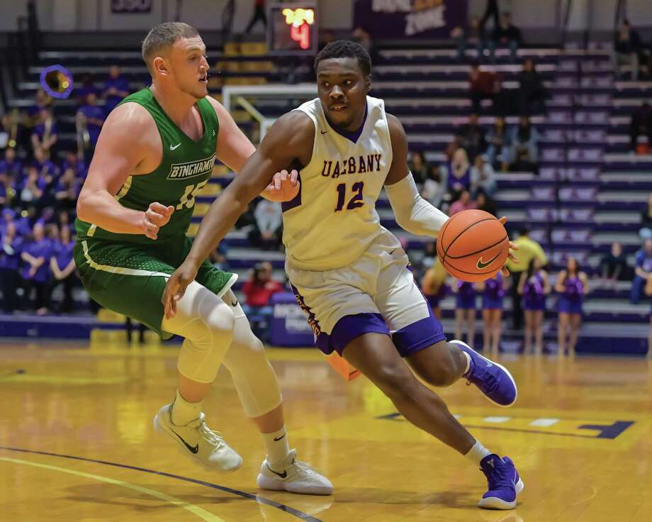 Devonte Campbell drives past a Binghamton defender during last night?s game at SEFCU Arena. The Great Danes won 71-54. Photo: Bill Ziskin / © Bill Ziskin Photography LLC
