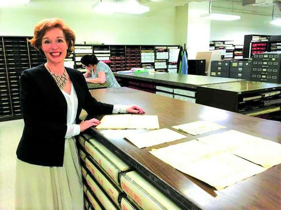 Madison County Recorder Amy Meyer with historical documents in her office in the Madison County Administration Building. Photo: Steve Horrell | For The Telegraph