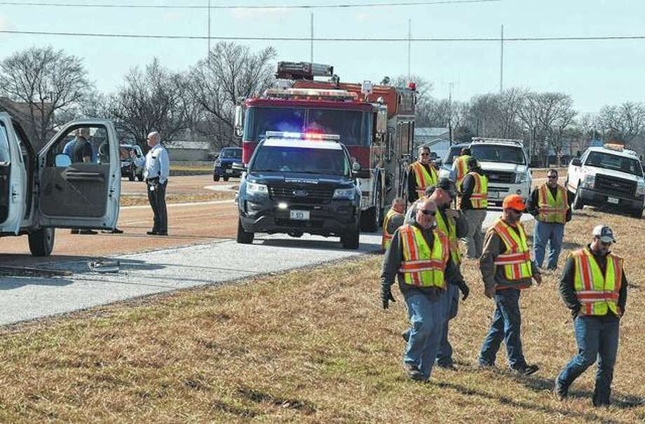 Illinois Department of Transportation workers and Jacksonville emergency crews respond to the scene of an accident Monday on East Morton Avenue. Photo: Nick Draper | Journal-Courier