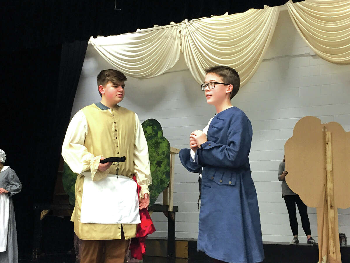 """Josh Stout, left as the Baker, and Jacob McKey as the Mysterious Man, rehearse for Liberty Middle School's Act I production of its spring musical, """"Into the Woods, Jr."""" Show times are 6:30 p.m. on March 1 and March 2 as well as a 2 p.m. matinee on March 3. Tickets are $5 each and can be purchased, for the first time, online."""