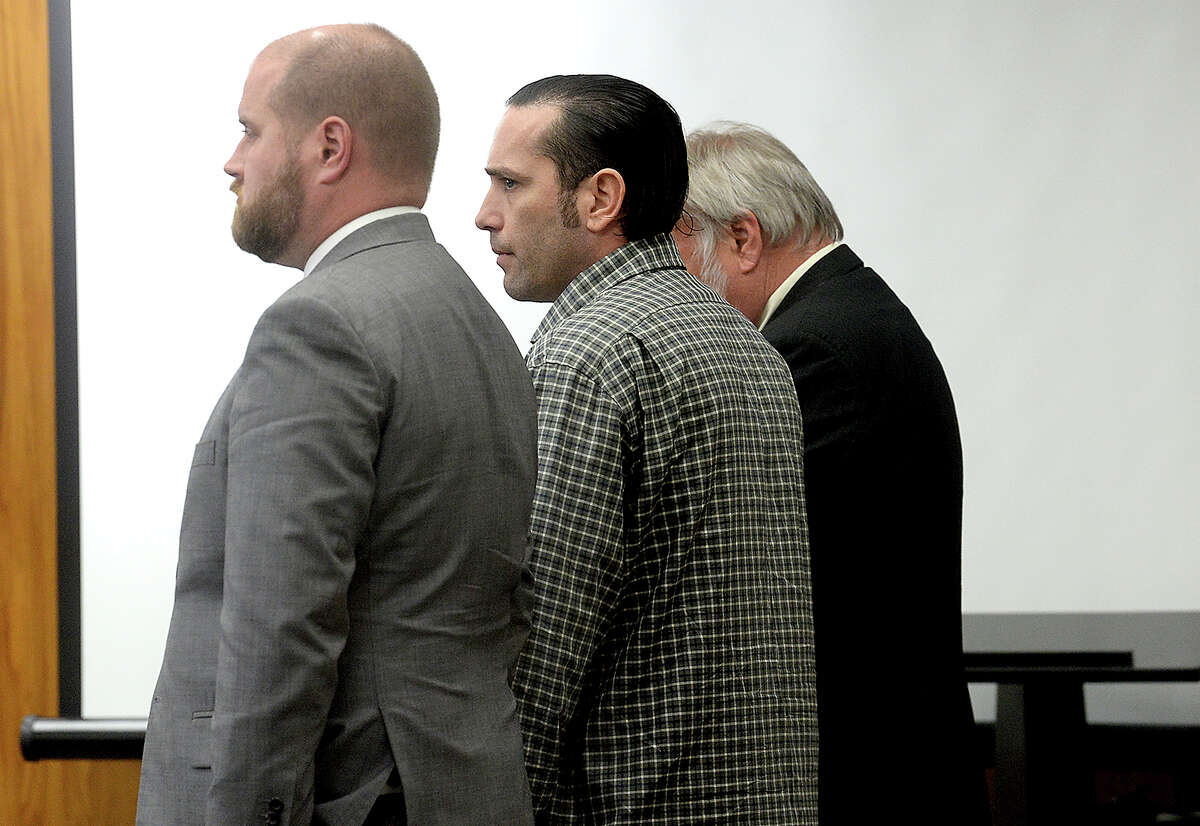 Jason Wade Delacerda stands with his attorneys Ryan Gertz (left) and James Makin as the sentencing is read in Judge Steve Thomas' Hardin County District Court Tuesday. The jury deliberated for over three hours before unanimously voting for a death sentence for Delacerda, who was found guilty of capital murder in the 2011 death of Breonna Nichole Loftin. Delacerda is the first person to receive the death sentence in Texas in 2018. Photo taken Tuesday, February 27, 2018 Kim Brent/The Enterprise