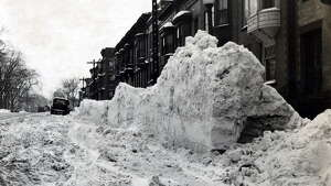 Snow is piled up at the side of Madison Ave. between South Knox and New Scotland Ave. following a winter snowstorm March 3, 1948, in Albany, N.Y. Historic streets, blizzard, snow. (Times Union archive)