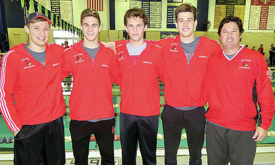 From left, Alton High senior swimmer Cole Akal, sophomore Noah Clancy, senior Matthew Daniel, junior Caden Akal and their coach, Garth Akal. The Redbirds qualified for this weekend IHSA state meet in seven events, including five individual races and two relays. Photo: Submitted Photo