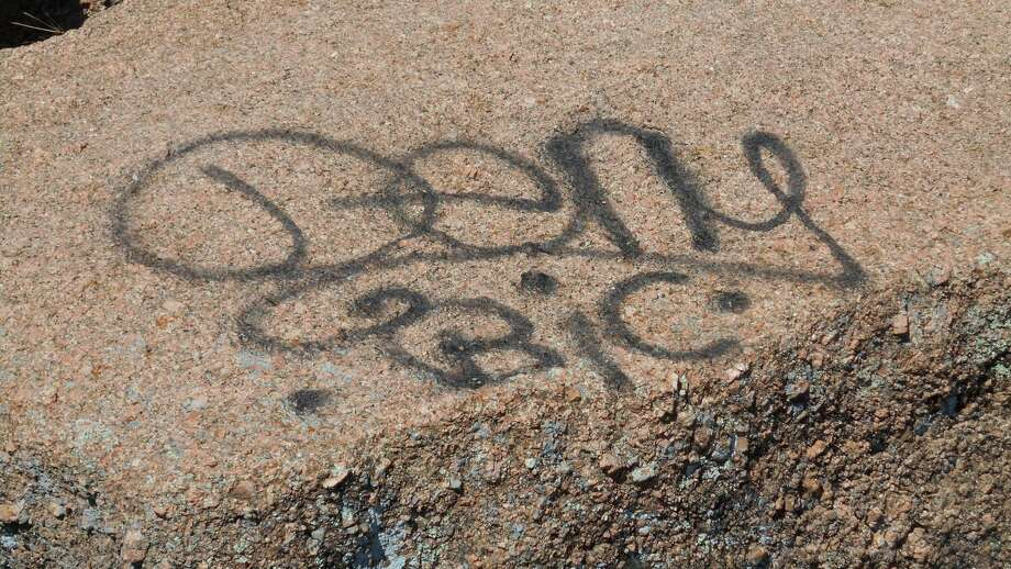 "Graffiti reading ""deny BIC"" was discovered at Enchanted Rock State Natural Area Feb. 25, 2018. Photo: Courtesy/Texas Parks And Wildlife Department"