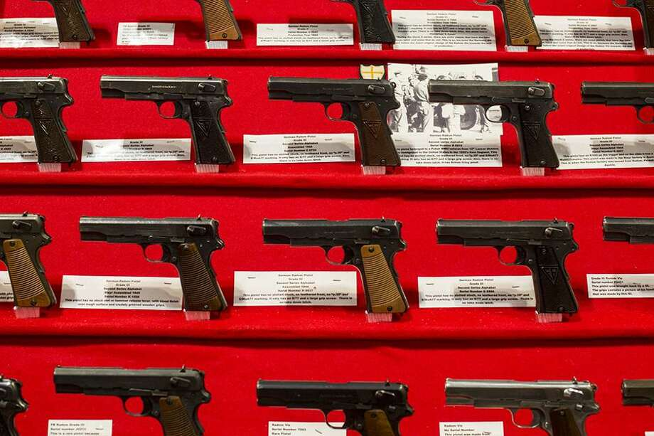 FILE — Handguns are lined at at a booth during the National Rifle Association's annual meeting in Nashville, Tenn., April 10, 2015. Caught in an angry social media storm, a number of marketers have ended promotions linked to the NRA, but it's unclear whether boycotts have a lasting impact. (Joe Buglewicz/The New York Times) Photo: JOE BUGLEWICZ, STR / NYT / NYTNS