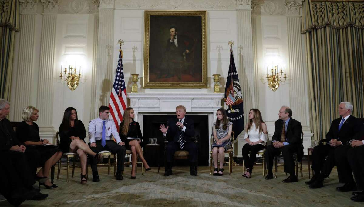 In this Feb. 21, 2018, photo, President Donald Trump hosts a listening session with high school students, teachers and parents in the State Dining Room of the White House in Washington. Trump could face a backlash from gun rights advocates who fear he?'s strayed from his pledge to be a champion for the Second Amendment by voicing support for gun control measures in the wake of the deadly school shooting in Florida. (AP Photo/Carolyn Kaster, File)