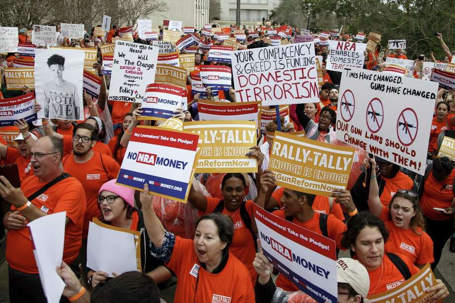 TALLAHASSEE, FL - FEBRUARY 26: Activists hold up signs at the Florida State Capitol as they rally for gun reform legislation on February 26, 2018 in Tallahassee, Florida. In the wake of the February 14 school shooting that left 17 people dead, hundreds of people joined the Parkland students to call for gun reform. (Photo by Don Juan Moore/Getty Images) Photo: Don Juan Moore, Stringer / Getty Images / 2018 Getty Images