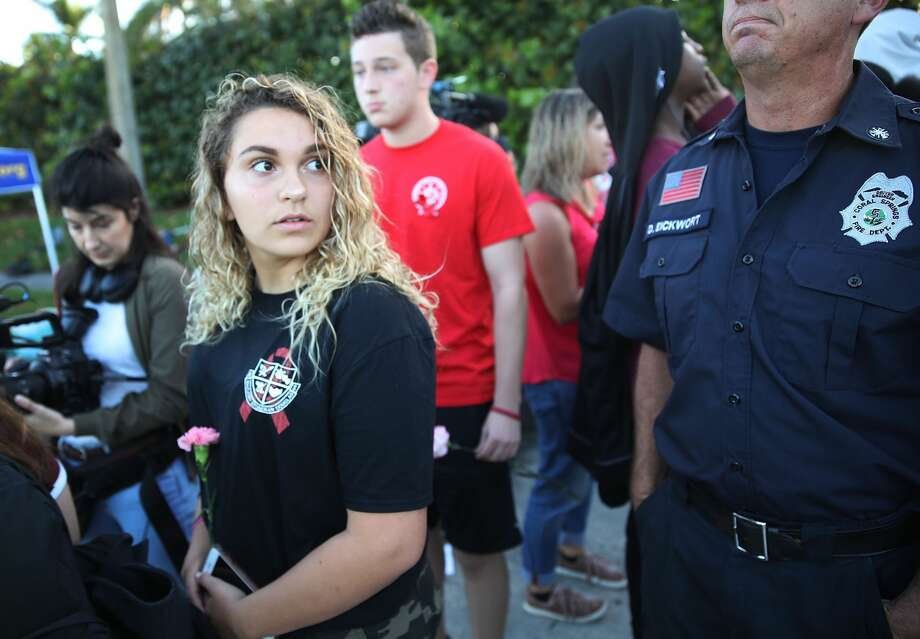 Click ahead to see photos of Parkland students returning to Marjory Stoneman Douglas High SchoolStudents walk to Marjory Stoneman Douglas High School as they attend classes for the first time since the shooting that killed 17 people on February 14  at the school on February 28, 2018 in Parkland, Florida.  Police arrested 19-year-old former student Nikolas Cruz for the 17 murders.  (Photo by Joe Raedle/Getty Images) Photo: Joe Raedle/Getty Images