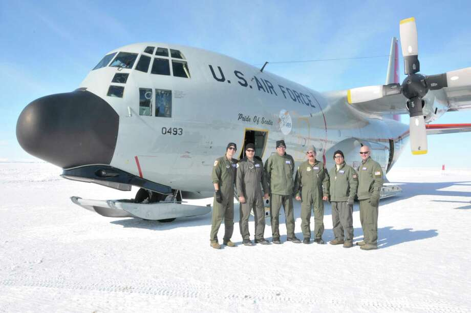 "This LC-130 ""Skibird"" crew landed at the South Pole Station with minimum visibility and maximum crosswinds, and then were forced to make an emergency weather divert to Terra Nova Bay when extreme weather made it unsafe to land at McMurdo Station on Nov. 9, 2017. The crew (from left): 1st Lt. Brian Alexander, co-pilot; Airman 1st Class Ryan Rhoads, loadmaster; Lt. Col. Ronald Ankabrandt, navigator; Senior Master Sgt. Michael Messineo, flight engineer; Senior Master Sgt. David Vesper, loadmaster; and Capt. Brandon Caldwell, pilot. The 139th Expeditionary Airlift Squadron crew and LC-130 are deployed to Antarctica in support of Operation Deep Freeze, the logistical support provided by the Department of Defense to the U.S. Antarctic Program. (U.S. Air National Guard photo by Master Sgt. Catharine Schmidt) Photo: MSgt Catharine Schmidt"