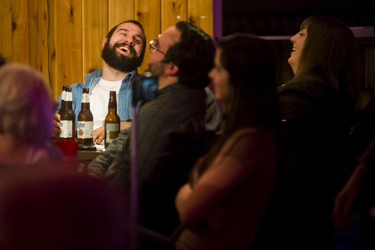 Audience members laugh while listening to stand-up comedy during a weekly free comedy show on Tuesday, Feb. 27, 2018 at 702 Bar in Midland. (Katy Kildee/kkildee@mdn.net)