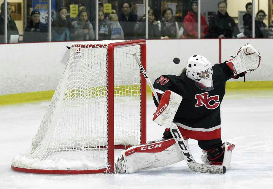 New Canaan goalie Blythe Novick, seen here blocking away a shot, is one of the New Canaan freshmen experiencing her first state playoffs. Photo: Matthew Brown / Hearst Connecticut Media / Stamford Advocate
