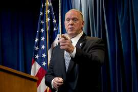 "File - In this Dec. 5, 2017 file photo, then Acting Director for U.S. Immigration and Customs Enforcement Thomas Homan takes a question from a reporter at a Department of Homeland Security news conference in Washington. A federal immigration official says about 800 people living in Northern California were able to avoid arrest because of a warning by Oakland Mayor Libby Schaaf. Homan, the Immigration and Customs Enforcement chief, told ""Fox and Friends"" Wednesday, Feb. 28, 2018, that what Schaaf did was ""no better than a gang lookout yelling 'police' when a police cruiser comes in the neighborhood."" (AP Photo/Andrew Harnik, File)"