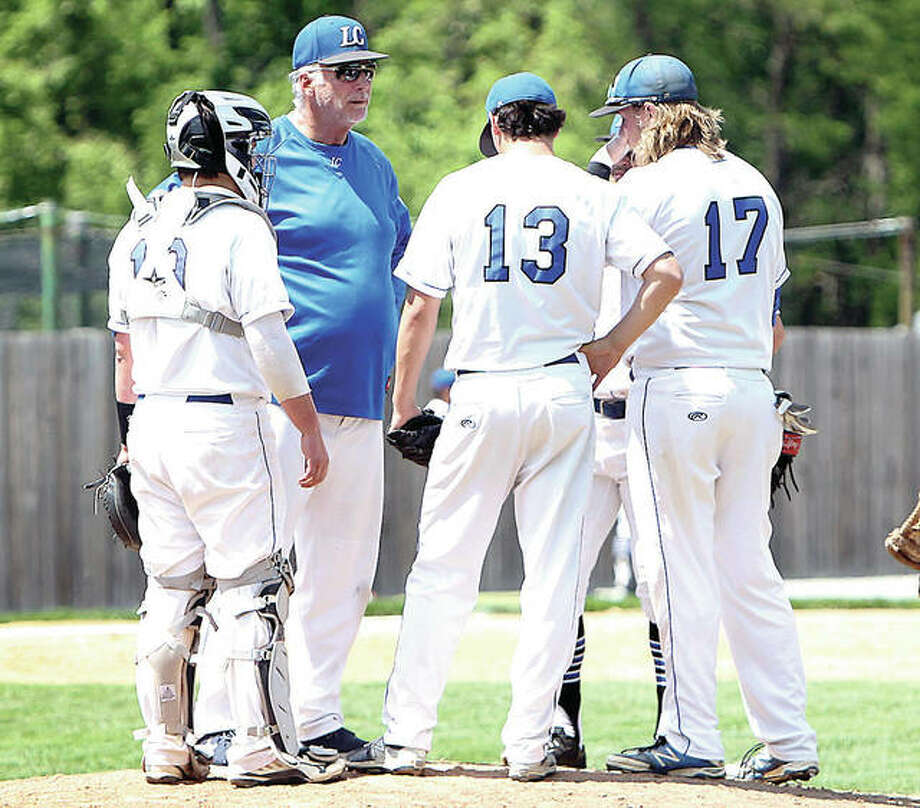 Lewis and Clark Community College baseball coach Randy Martz, second from left, and his Trailblazers are set to begin the season Thursday at rival Southwestern Illinois College in Belleville. Martz is shown making a a visit to the mound during a game last season. Photo: LC Athletics