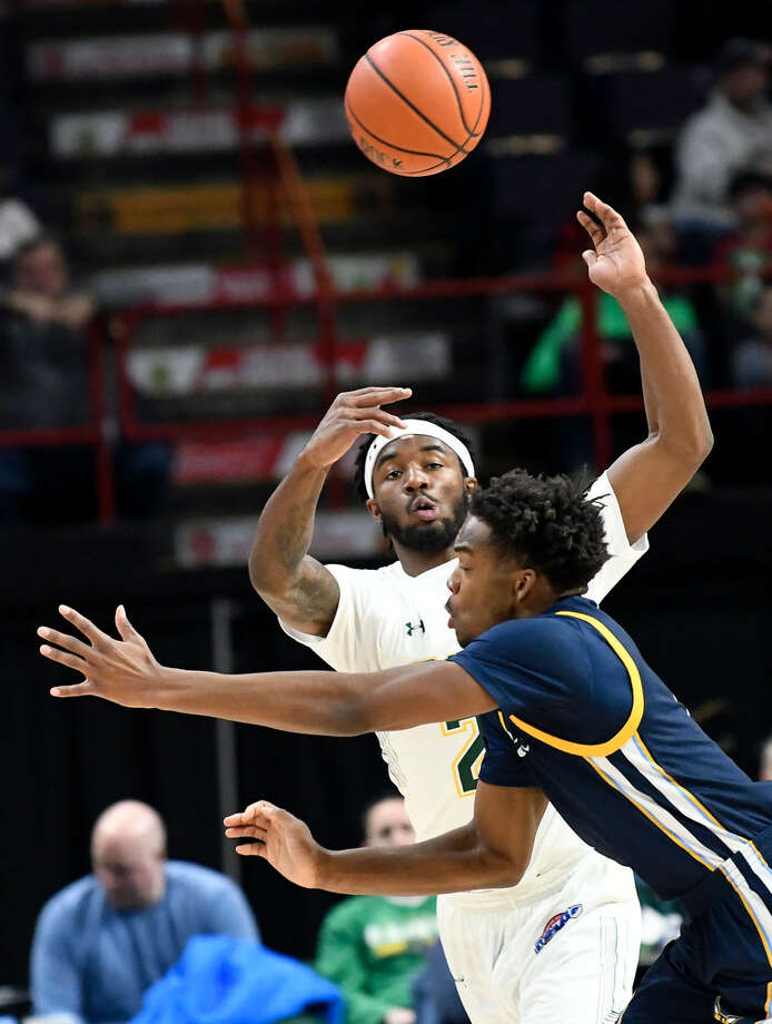 Quinnipiac guard Cameron Young, shown playing against former Siena guard Nico Clareth in January, is averaging 18.9 points per game this season. (Hans Pennink/Special to the Times Union)