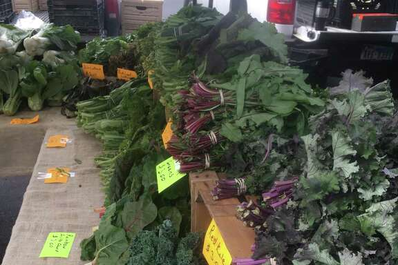 Greens are abundant throughout the area farmers markets, such as this table from 9-1 Produce Farm that sets up on Sundays at the Quarry Farmers Market.