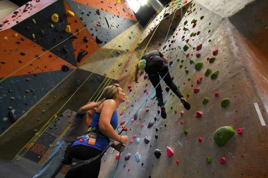 Linda Thakur spots climber Amy Reese on her climb of the 45-foot-tall wall at the Spring location of InSPIRE Rock. The gym is opening a new facility in Cypress with 24,000 square feet of climbing space and up to 63 foot-high walls. The facility will be located on a 45-acre sports and business complex on House Hahl Road in Cypress. Photo: Tony Gaines/ HCN, Staff / Houston Chronicle
