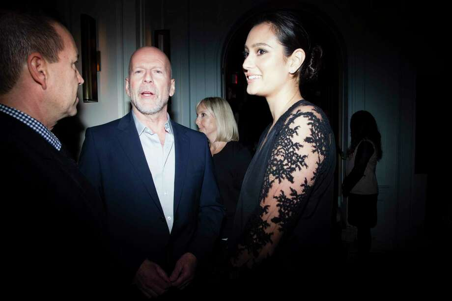 Bruce Willis with his wife, Emma Heming at a private dinner at Harlow on East 56th Street following Glamour magazineOs Women of the Year Awards at Carnegie Hall in New York, Nov. 10, 2014. The annual gala brought together female leaders from fashion, policy, comedy and philanthropy Monday night, and honorees included Chelsea Clinton and Lupita NyongOo.  (Deidre Schoo/The New York Times) ORG XMIT: XNYT109 Photo: DEIDRE SCHOO / NYTNS