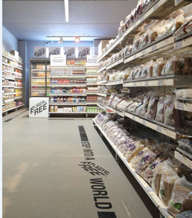 A plastic-free aisle at Ekoplaza supermarket in Amsterdam. While some of the packaging may look plastic, it's actually a biofilm made of trees and plants that will break down within 12 weeks in a home composter. Photo: Ekoplaza. / The Washington Post