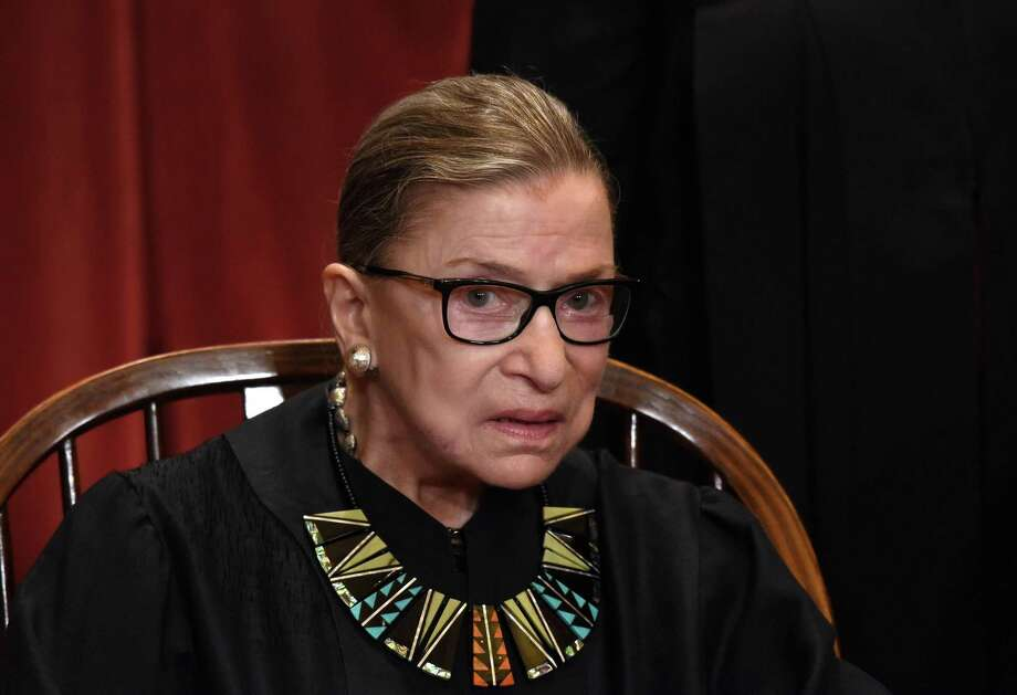 Investors should've first been tipped off that LeadInvest, a company reportedly peddling cryptocurrency-related investments, was misleading when they browsed the company's website and found a photo of a group that included Supreme Court Justice Ruth Bader Ginsburg (pictured). Photo: Olivier Douliery /TNS / Abaca Press