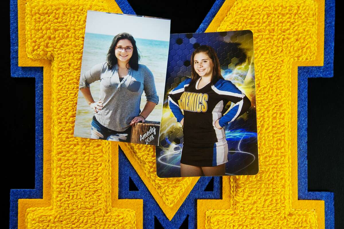 Amedy Dewey, 18, attended Midland High and is still recovering from injuries sustained in a shooting in January. Dewey is pictured here in senior photos with the varsity letter she earned on the cheer team. (Katy Kildee/kkildee@mdn.net)