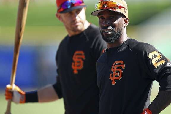 San Francisco Giants' Evan Longoria, left, and Andrew McCutchen wait to bat during practice prior to a spring training baseball game against the Arizona Diamondbacks on Tuesday, Feb. 27, 2018, in Scottsdale, Ariz. (AP Photo/Ben Margot)