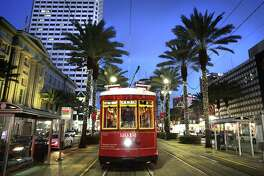 A street car runs along Canal Street in New Orleans, where the city is celebrating its Tricentennial this year.