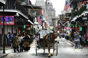A chilly scene on Bourbon Street in the New Orleans French Quarter where residents and visitors are celebrating the city's Tricentennial.