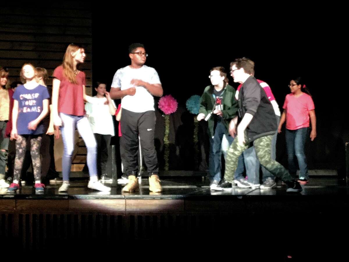 Members of Lincoln Middle School's Act 1 Drama Club rehearse in preparation for their performance of