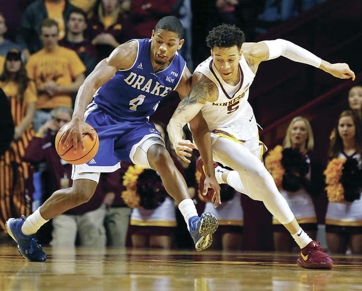 Drake's De'Antae McMurray (left) battles Minnesota's Amir Coffey for a loose ball during a game Dec. 11 in Minneapolis. McMurray, an Alton native, will be in St. Louis with the Bulldogs for their opening game Friday at the Missouri Valley Conference Tournament. He is wrapping up a successful college career after a successful prep career split split between Marquette Catholic and Alton High School.