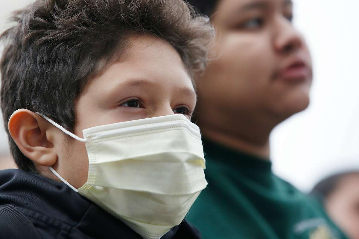 Eric, 11, Urban Promise Academy 6th grader, wears a mask as he and other youth demonstrate against the proposed repeal of the Clean Power Plan outside the San Francisco Main Library where the U.S. Environmental Protection Agency was holding a listening session on the proposed repeal of the Clean Power Plan on February 28, 2018, in San Francisco, Calif.