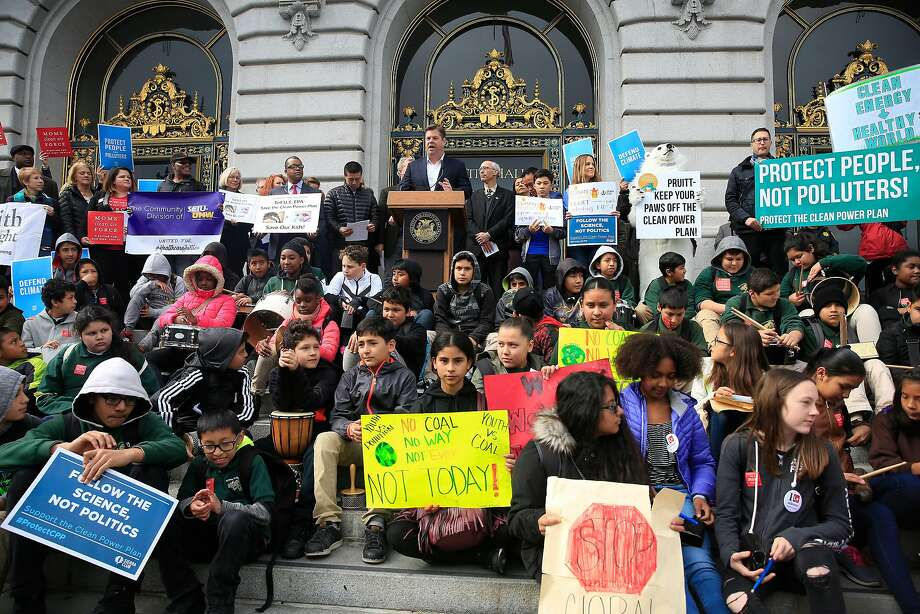 Mayor Mark Farrell speaks during a rally outside City Hall as youth from Oakland sit on the City Hall steps as they rally with others against the proposed repeal  of the Clean Power Plan. Photo: Lea Suzuki, The Chronicle
