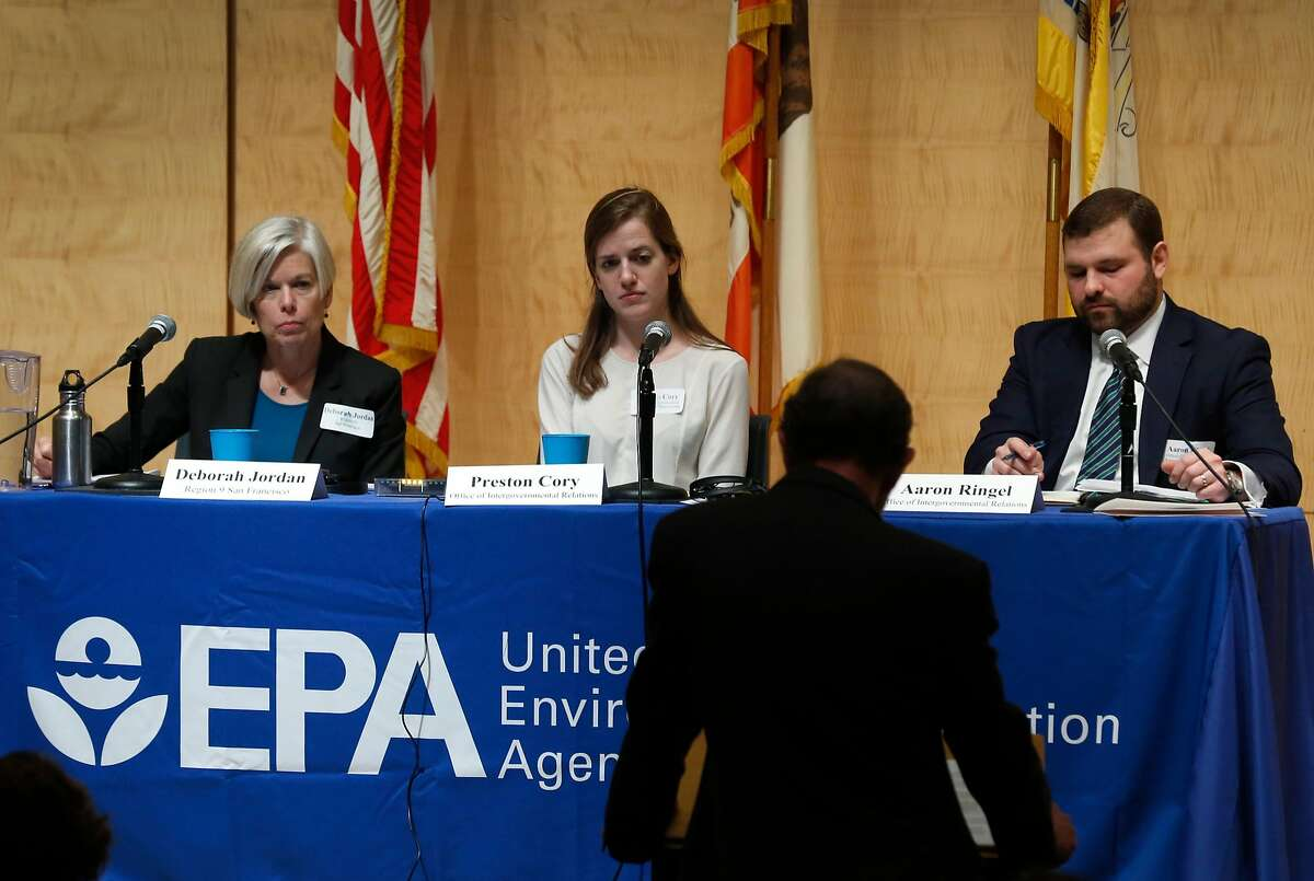 Representatives from the U.S. Environmental Protection Agency hear speakers during a listening session on the agency�s proposal to repeal the Clean Power Plan at the main library branch in San Francisco, Calif. on Wednesday, Feb. 28, 2018.