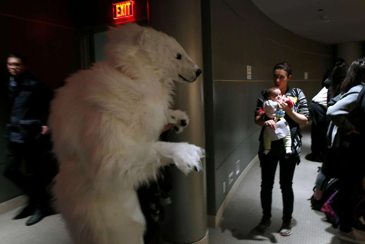 An environmentalist dressed in a polar bear costume attends a listening session on the U.S. Environmental Protection Agency's proposal to repeal the Clean Power Plan at the main library branch in San Francisco, Calif. on Wednesday, Feb. 28, 2018.