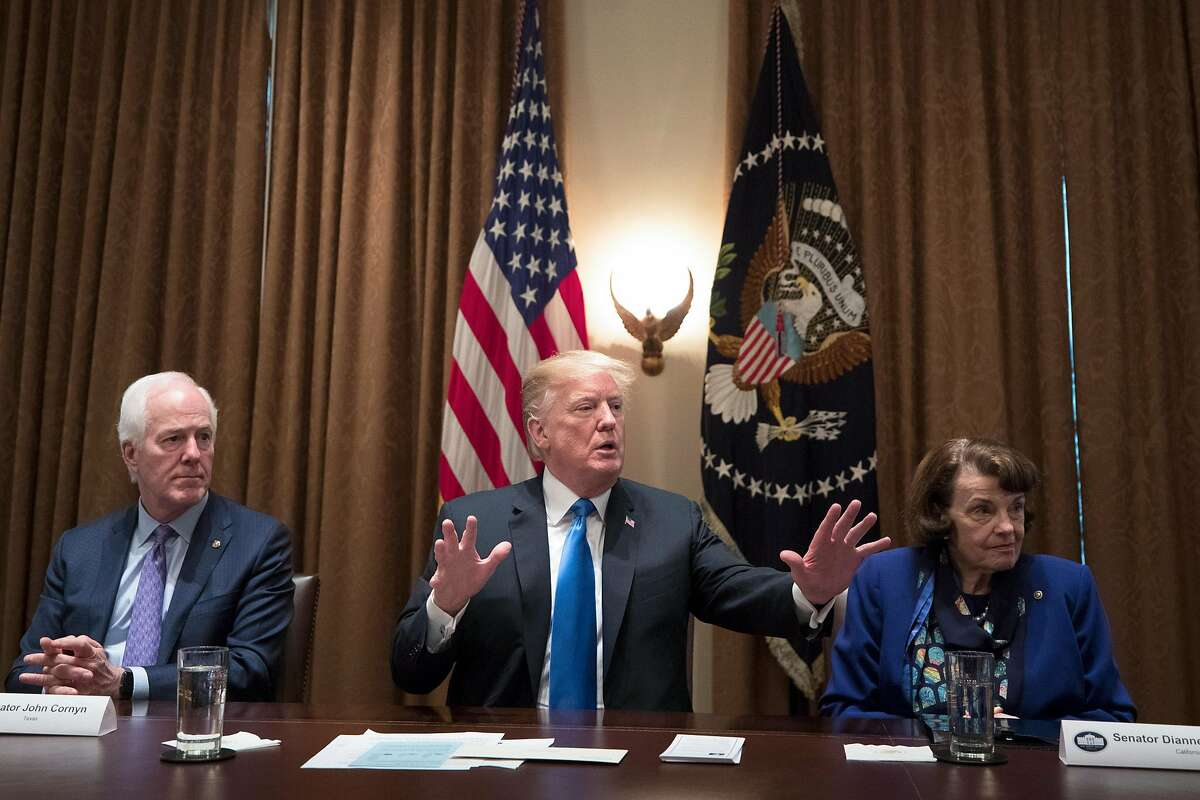 President Donald Trump speaks during a bipartisan round-table discussion on gun control at the White House in Washington, D.C., on Feb. 28, 2018.From left: Sen. John Cornyn (R-Texas); Trump; and Sen. Dianne Feinstein (D-Calif.).