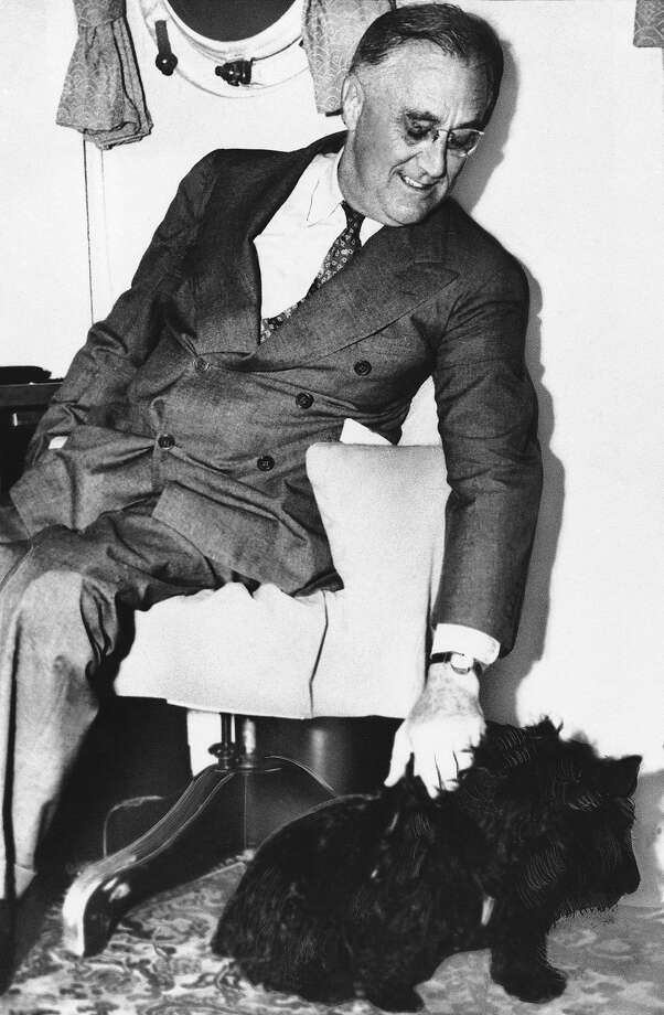 Shown in an undated photo of United States President Franklin D. Roosevelt with his pet dog ?Fala?. (AP Photo) Photo: ASSOCIATED PRESS