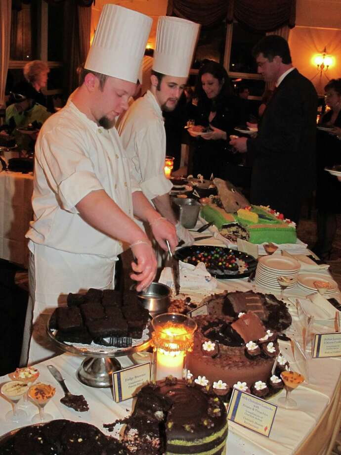 Competitors at a past Confections in Chocolate fundraiser offers samples of their sweet creations to patrons. (Times Union file photo.)