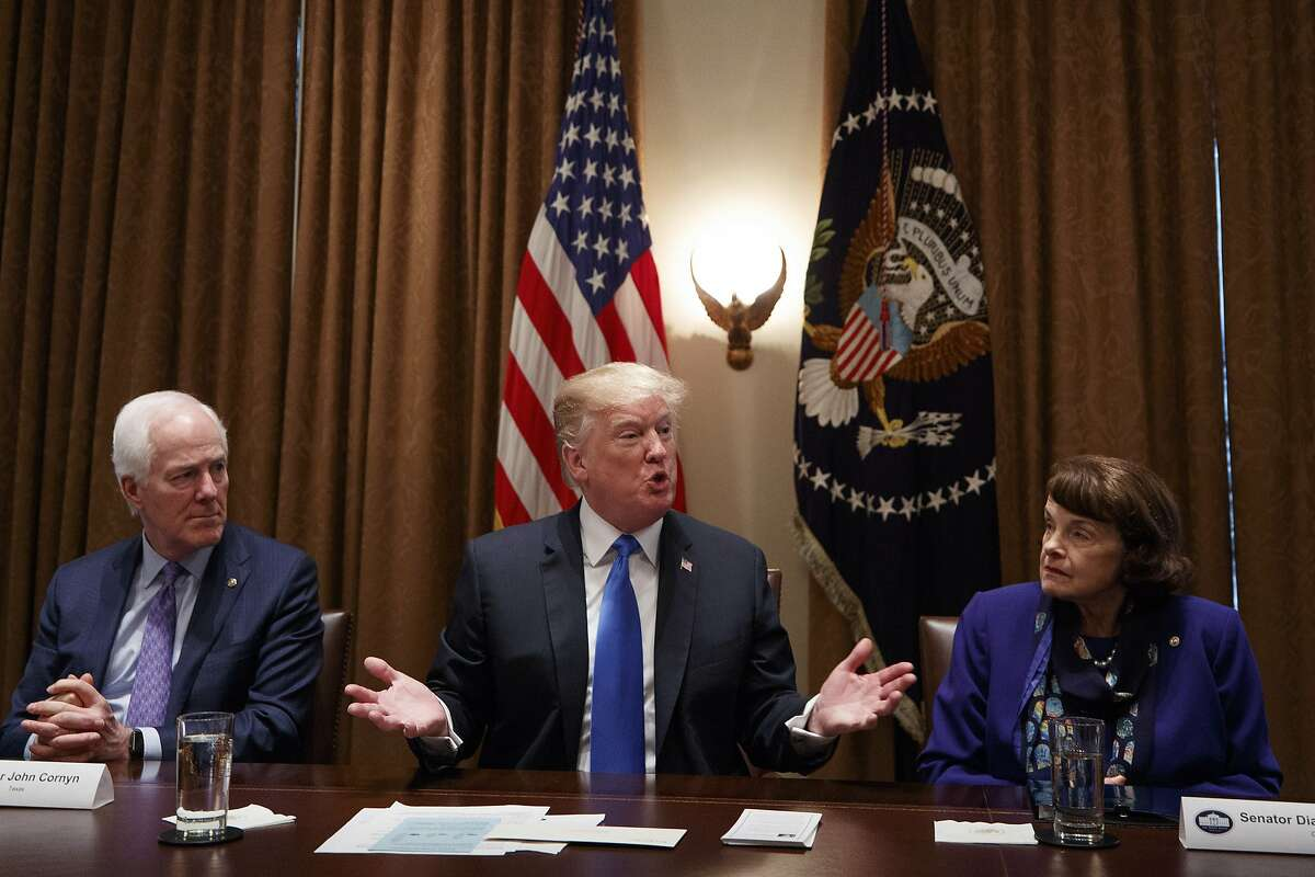 President Donald Trump speaks during a bipartisan round-table discussion on gun control at the White House in Washington, D.C., on Feb. 28, 2018. Trump repeatedly embraced a series of gun control measures here Monday. From left: Sen. John Cornyn (R-Texas); Trump; and Sen. Dianne Feinstein (D-Calif.).