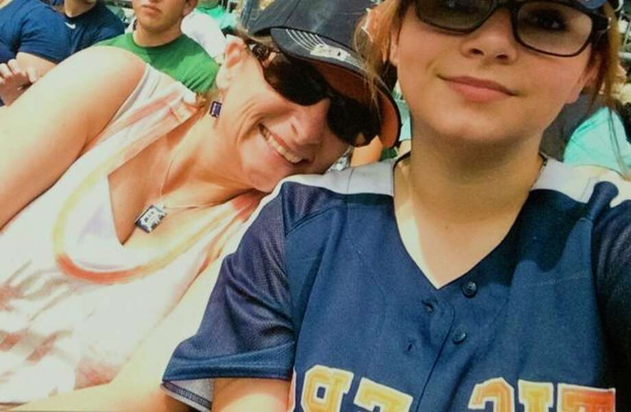 Amedy Dewey, 18, attended Midland High and is still recovering from injuries sustained in a shooting in January. Dewey is pictured here with her mother, Lisa Somers, at a Tigers baseball game. (Photo provided)