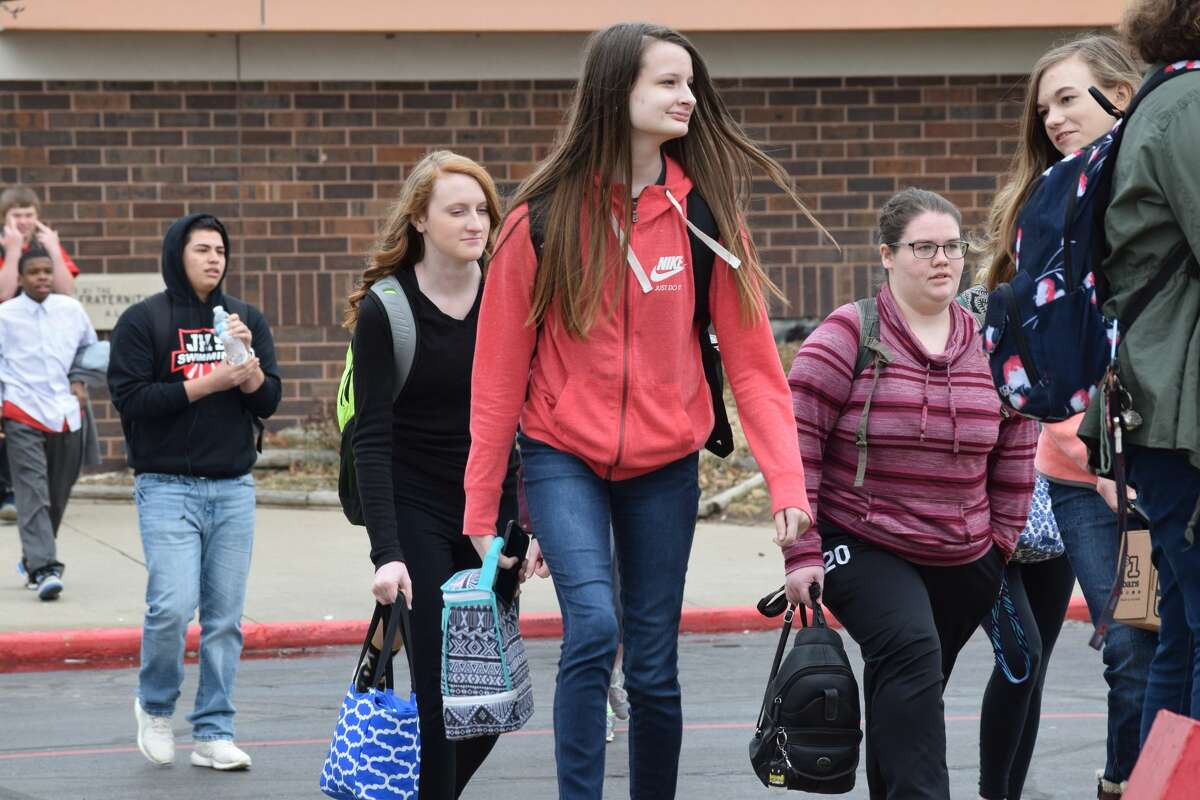 Dozens of Jacksonville High School students left classes Wednesday to show their support for gun regulation and in memory of those who are victims of school shootings.