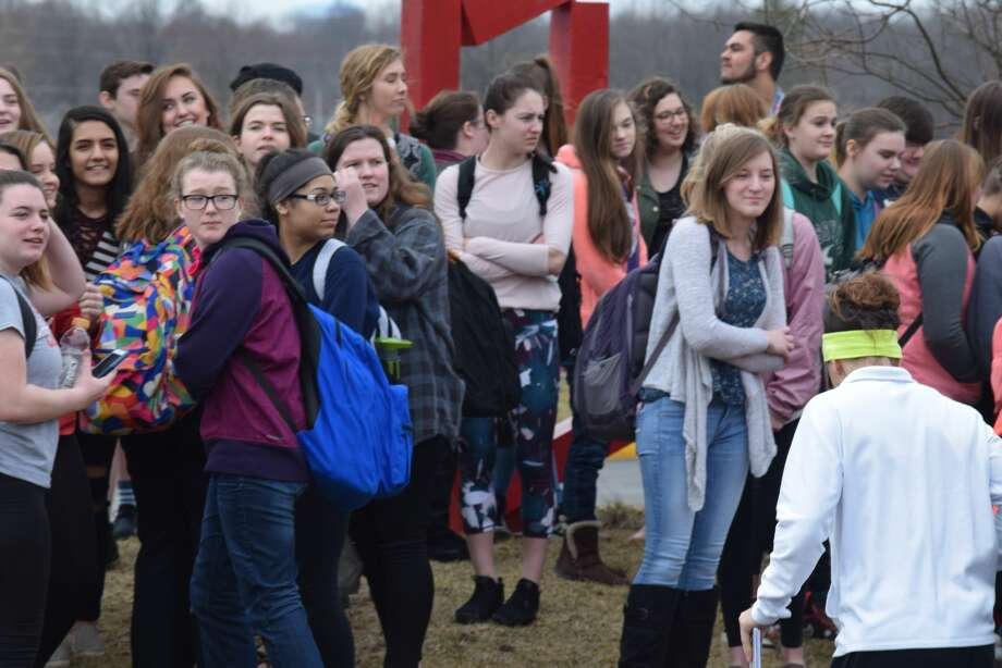 Dozens of Jacksonville High School students left classes Wednesday to show their support for gun regulation and in memory of those who are victims of school shootings. Photo: Nick Draper | Journal-Courier