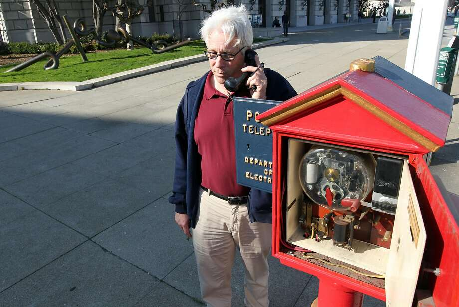 City worker Jack Donohoe with a blue police and red fire department call box. Photo: Lance Iversen, The Chronicle
