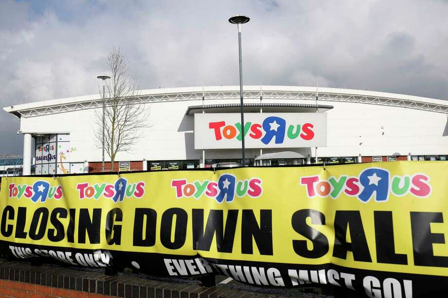 FILE - In this Feb. 27, 2018 file photo, a branch of Toys R Us at St Andrews retail park in Birmingham, England, displays a closing down sale banner. The British arm of Toys R Us has gone into insolvency administration, Wednesday Feb. 28, 2018, putting 3,200 jobs at risk. (Aaron Chown/PA via AP, File) Photo: Aaron Chown / PA