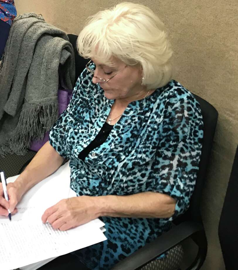 Caye Hauser filed a complaint with the Brazoria County district attorney after noticing a discrepancy in the number of acres the city had listed on an annexation ordinance.