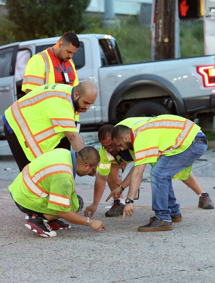 Two truckers flip coins to determine who will get to tow the two vehicles that were involved in a crash at the intersection of Southwest Freeway Service Road and Newcastle Drive on May 30.