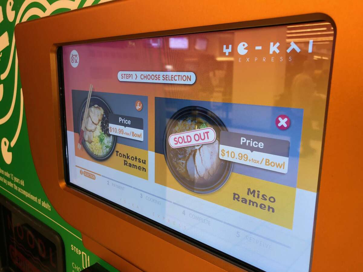 A touchscreen on the vending machine walks you through the ordering process.
