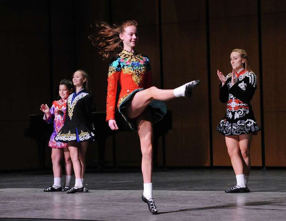 At center, Alice Walker, 13, of Greenwich, along with fellow dancers from the Harney Pender Keady Academy of Irish Dance of Stamford, perform as part of Diversity Week at the Greenwich High School Performing Arts Center, Conn., Tuesday, Feb. 27, 2018. Photo: Bob Luckey Jr. / Hearst Connecticut Media / Greenwich Time